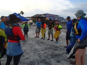 Kayaking puts us in contact with the community. This was briefing on a beach cleanup project.